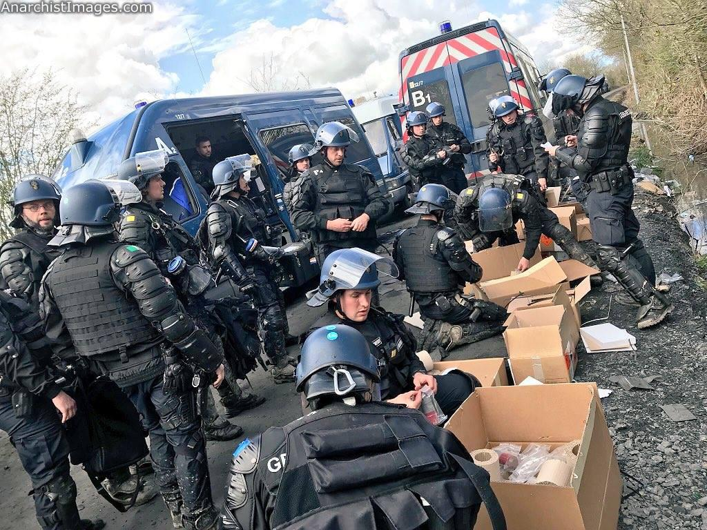 Cops unpacking teargas grenades at It looks like the second wave of evictions at #ZAD #NDDL will start Image by Twitter account @cortegedetete